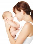 foto of cuddle  - Happy mother holding newborn baby over white background - JPG