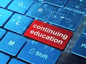 Education concept: Continuing Education on computer keyboard bac