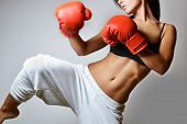stock photo of brunette  - beautiful woman with the red boxing gloves - JPG