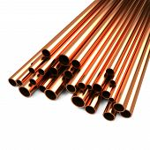 stock photo of pipeline  - Stack of Copper Pipes Isolated on White Background - JPG