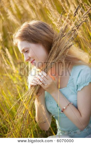 Young Woman With High Grass