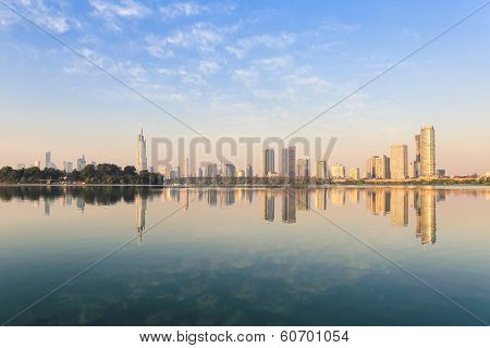 Modern City Skyline With The Beautiful Lake