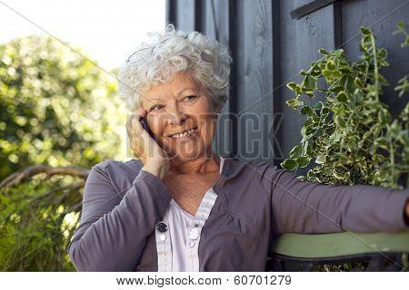 Happy Elderly Woman Making A Phone Call