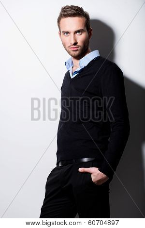 Fashion Portrait Of Young Man In Black Pullover.