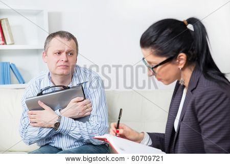 Business man talking to his psychiatrist