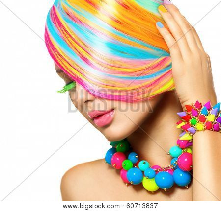 Beauty Girl Portrait with Colorful Makeup, Hair, Nail polish and Accessories. Colourful Studio Shot of Funny Woman. Vivid Colors. Manicure and Hairstyle. Rainbow Colors. Colored hair