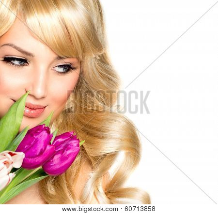 Beauty Woman with Spring Flower bouquet. Beautiful girl with a Bouquet of Tulip flowers. Isolated on a white background. Happy surprised model woman smelling flowers. Mothers Day