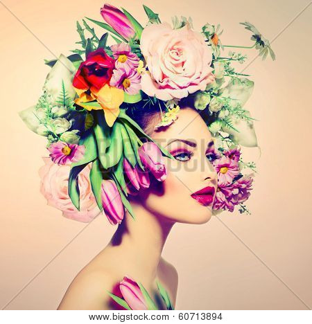 Spring Woman. Beauty Girl with Flowers Hair Style. Beautiful Model woman with Blooming flowers on her head. Nature Hairstyle. Summer. Holiday Creative Makeover. Fashion Makeup. Make up. Vogue Style
