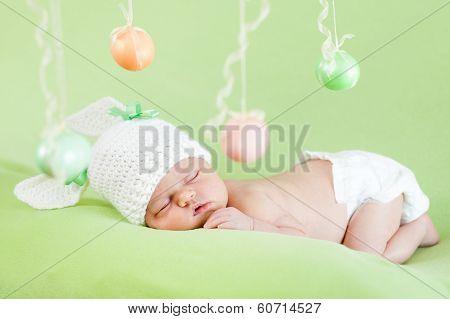 Newborn Baby Dressed In Easter Bunny Cap