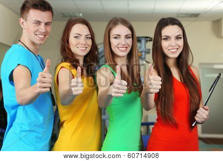 Young beautiful peoples in gym