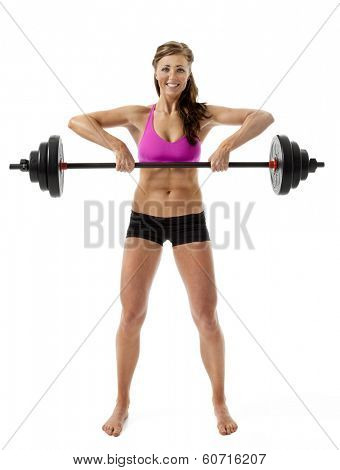 Full length front view of attractive young woman lifting barbell on white background.