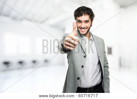 Young man doing thumbs up sign