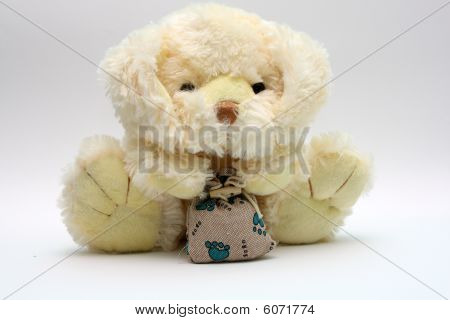 The soft plush dogie with a sack