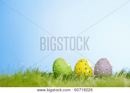 Decorated easter eggs in spring green grass