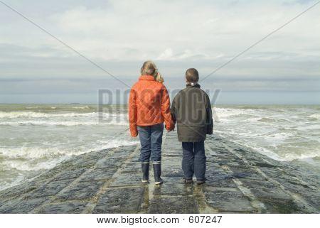 Children On A Wave-breaker