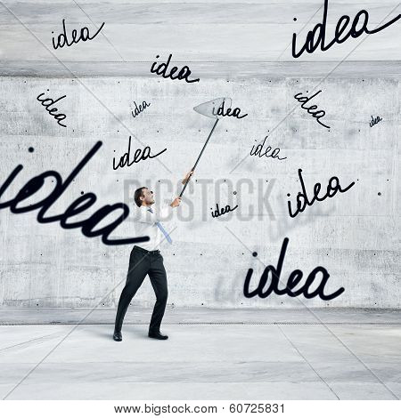 Businessman catching ideas with a butterfly net