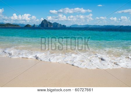 Blue Sea Wave On White Sand Beach