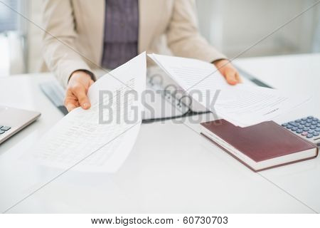 Closeup On Clueless Business Woman With Documents