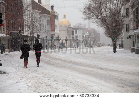 Pedestrians In Snow
