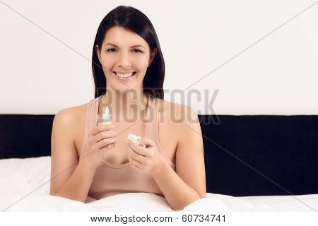 Smiling Young Woman With A Bottle Of Inhalant