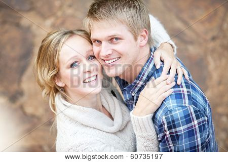 Young Couple In Love Looking Up At Viewer