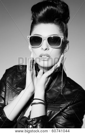 Beautiful Punk Woman Model Wearing Sun Glasses And Leather Jacket