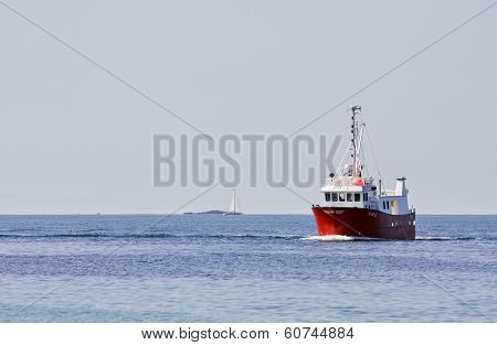 SOLA, NORWAY - JULY 01. Boie,a fishing boat in the inlet on July 01, 2010 in Sola, Norway.