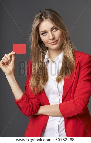 Business woman showing red card in hand