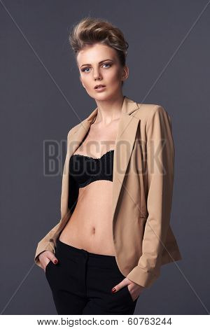 Sensual woman posing in unbuttoned jacket