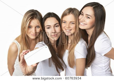Girls making self portrait with a smartphone