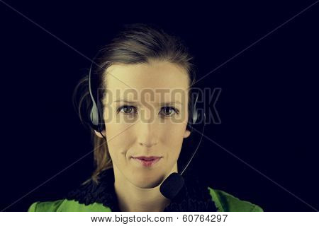 Dark Portrait Of A Young Woman Wearing A Headset