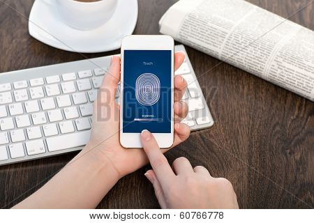 Female Hands Holding A White Touch Phone And Entering The Pin Code Of Fingerprint