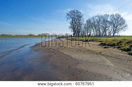 Small beach along a river in winter