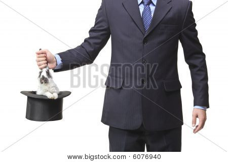 Businessman pulling a rabbit out