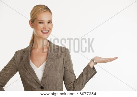 Businesswoman Holding Up Hand For Copy Space