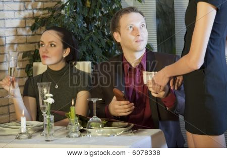 Man Paying Bill In Restaurant