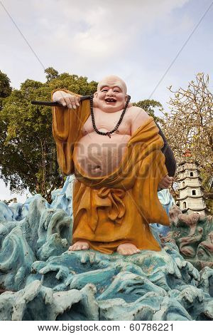 Ho Tai Happy Buddha Statue At Haw Par Villa