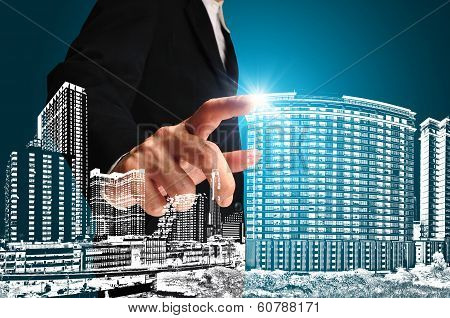 Business Man Or Achitect Touch The Drawing Of Building Or Cityscape