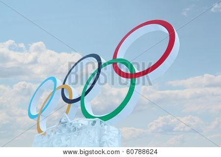 Perm, Russia - Jan 6, 2014: Cloudy Sky And Symbol Of Olympic Games In Ice Town, Created In Honor Of
