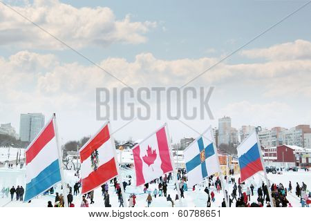 Perm, Russia - Jan 6, 2014: Flags Of Participating Countries And People Of Winter Olympic Games In I