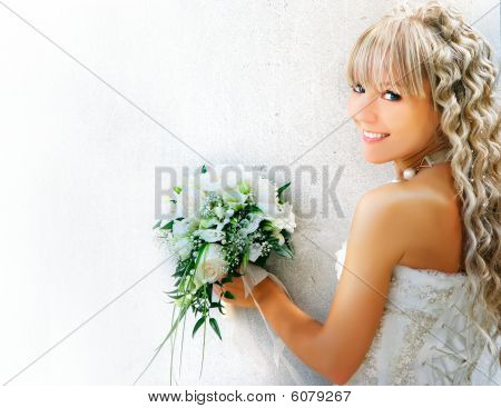Young Happy Bride Over White