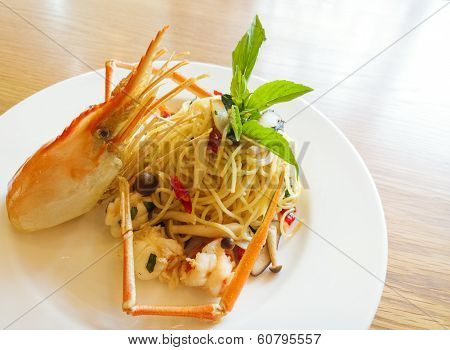 Italian Spaghetti Pasta And Fresh Spicy Shrimps Sauce On Wooden Table