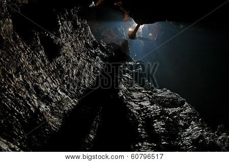 Caver Abseiling In A Pothole