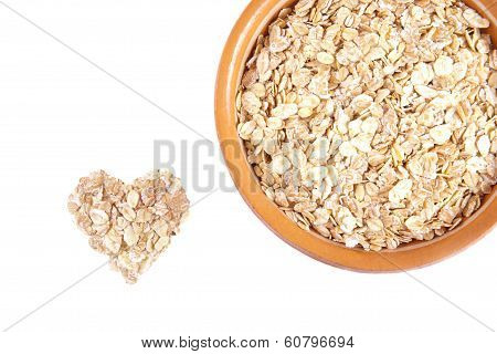 Oatmeal in a ceramic plate isolated on white background