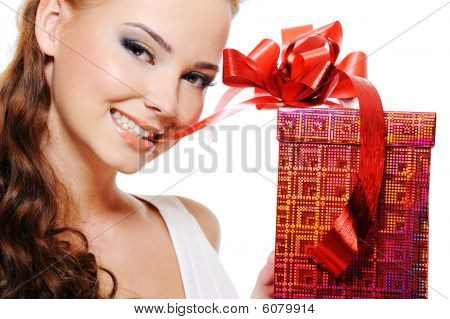 Beautiful Sexy Woman Face With A Christmas Gift