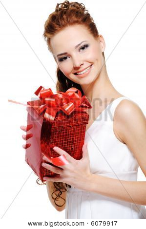 Attractive Young Female Holding Present Over White