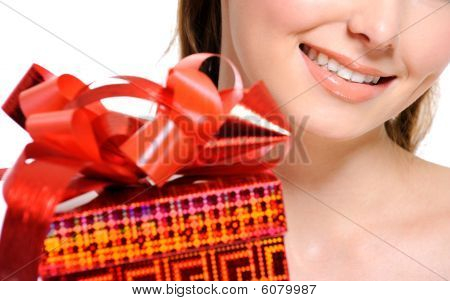 Unrecognizable Girl With A Red Present Box On Foreground