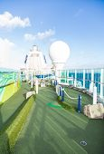 stock photo of miniature golf  - A green miniature golf course on a luxury cruise ship - JPG