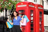 pic of phone-booth  - England London shopping woman shopper holding shopping bags by red phone booth - JPG