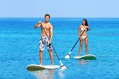 stock photo of hawaiian girl  - Paddleboard beach people on stand up paddle board surfboard surfing in ocean sea on Big Island - JPG